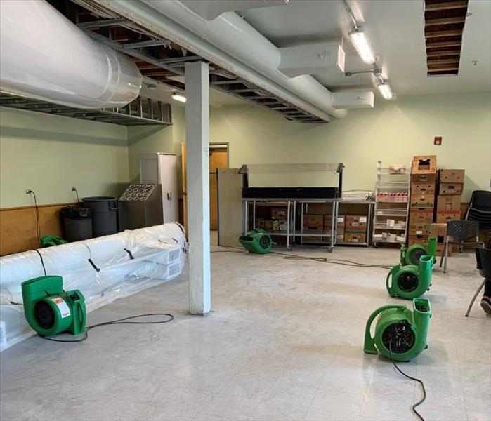 air movers drying a commercial water damage